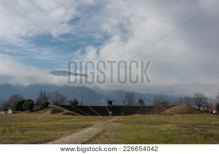 View Of Hellenistic Theater At The Archaeological Park Of Dion With Olympus Mount At Background. Pie
