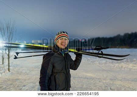 Image Of Smiling Man With Skis In Winter Forest On Blurred Background