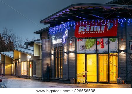 Parnu, Estonia - December 13, 2017: Evening View Of Rimi Supermarket In Festive Evening Night Christ