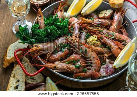 Prawns Shrimps Roasted With Lemon And Garlic In Iron Pan. Top View