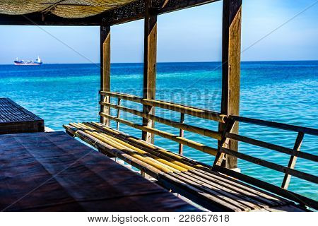 A Small Shack In An Island Overlooking A Beach