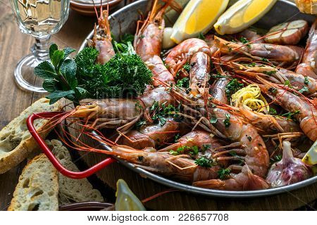 Close View Of Tiger Prawn Shrimps Roasted With Lemon Garlic And Wine.