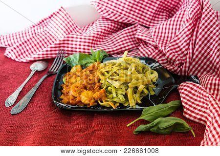 spaghetti with pesto sauce and Shrimp on a the table
