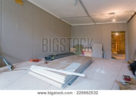 Working Process Of Installing Metal Frames For Plasterboard (drywall) For Gypsum Walls And Tools In