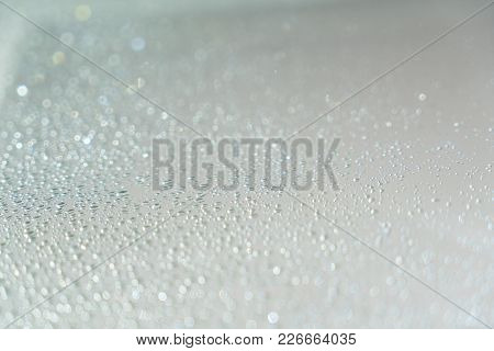 Close Up Of Raindrops On Window With Sunlight. Generic Background.