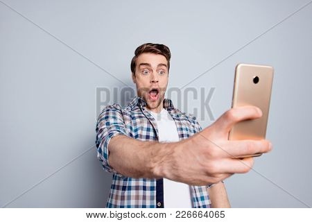 Amazed, Scared Guy In Checkered Shirt Having, Using Smart Phone, Watching Excited Video Through 3g,