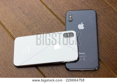 February 2018.two Iphone X Lies On A Wooden Table. A New Smartphones From The Company Apple Close-up