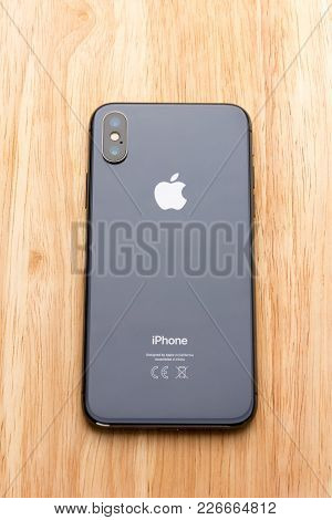 February 2018. Iphone X Lies On A Wooden Table. A New Smartphone From The Company Apple Close-up On