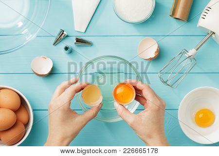Female Hands Separate Egg White From Yolk For Whipped Cream. Step By Step Recipe Of Meringue With In