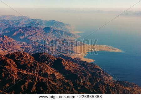 On The Horizon, The High Mountains Of Egypt, Coast With The Sea.