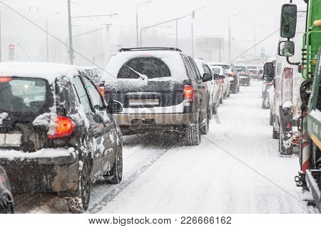 Traffic Jam On Moscow Road During Blizzard Snowstorm.