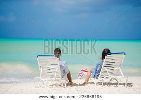 Couple Relaxing On A Tropical Beach At Maldives