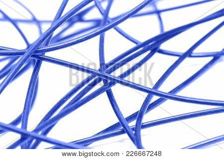 Blue Cable On A White Background . Photo Of An Abstract Texture