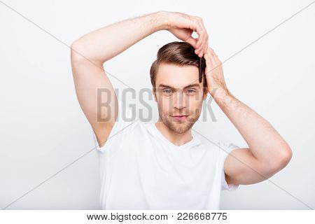 Confident, Stunning, Perfect Man In T-shirt Doing Modern Hairstyle, Holding Comb With Fingers, Brush