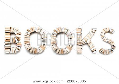 BOOKS word formed from books, shot from above on white background