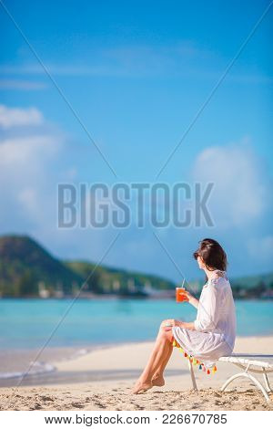 Young Woman With Cocktail Glass Near Swimming Pool