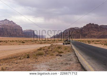 Wadi Rum Desert, A Valley Cut Into The Sandstone And Granite Rock In Southern Jordan