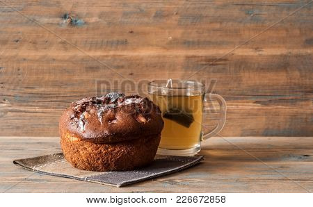 Breakfast table consisting of raisin bread and a cup of coffee