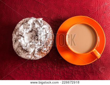 Cup of coffee and cake with raisins on red background