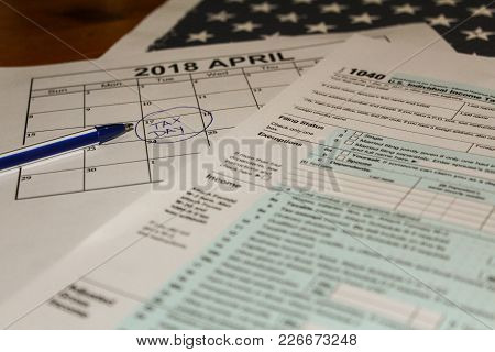 Calendar And Form 1040 Income Tax Form For 2017 Showing Tax Day For Filing Is April 17 2018 Usa Tax