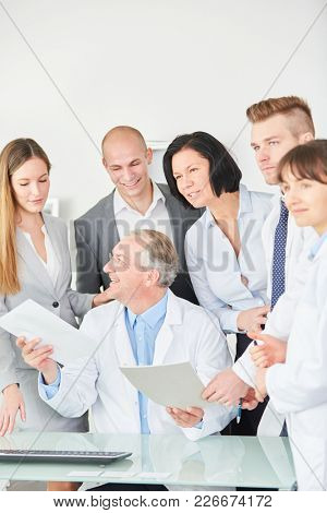 Team of doctors with boss and administration staff