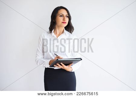 Ambitious Young Businesswoman Dreaming Of Success. Pensive Confident Business Consultant Making Note