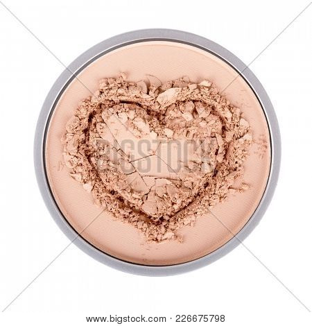 Face powder. Face powder in the form of heart. Make up crushed powder. Isolated on white background