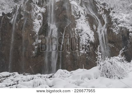 Plitvice Lakes National Park, snow covered nature. Natural landscape of frozen Plitvice Lakes National Park.