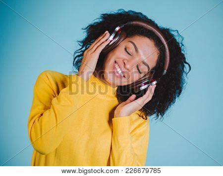 Lifestyle Concept. Portrait Of Beautiful African American Woman Joyful Listening To Music On Mobile