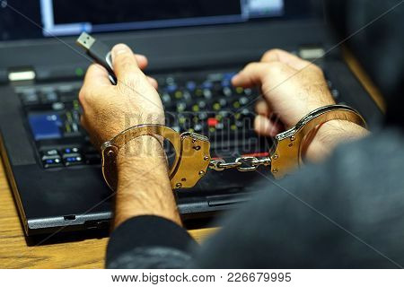 Close-up. Arrested Hacker Man Handcuffed Hands. Prisoner Or Arrested Terrorist, Close-up Of Hands In