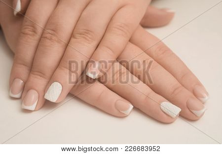 Light Manicure In Light On A White Background.