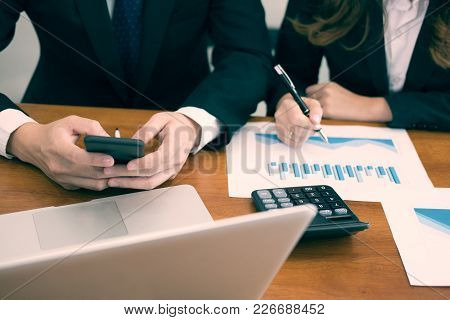 Young Businessman Analyze Financial Chart In Smartphone . Business Team Working With Startup Project