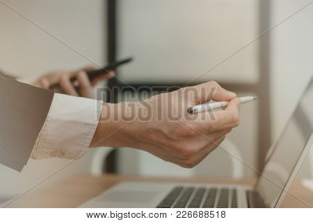 Young Businessman Analyze Financial Chart In Smartphone. Man Working With Startup Project. Business