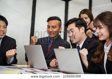 Business Team Raise Hands With Happiness For Successful Project. Cheerful Asian Businessman & Busine