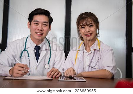 Confident Young Male & Female Doctor Smiling At Camera.  Portrait Of  Medical Staff, Physician Or Pr