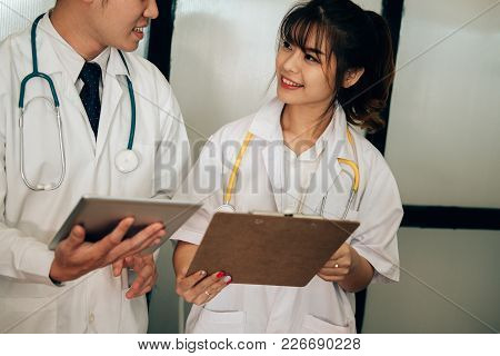 Doctor Discussing Patient Treatment. Medical Staff Have Meeting For Diagnosis Plan In Conference Roo