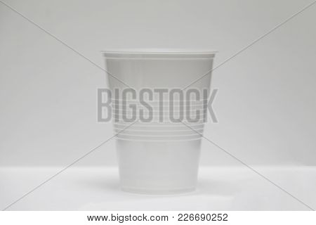 Clear Plastic Cup Shot Against A White Background
