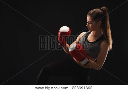 Side View Of A Gorgeous Young Woman With Boxing Gloves And Standing In Position, Ready To Fight, Cop