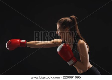 Side View Of Emotional Young Woman With Boxing Gloves And Standing In Position, Ready To Fight, Copy