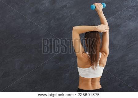 Fitness Model Woman With Dumbbells On Grey Studio Background, Back View. Bodybuilding, Healthy Lifes