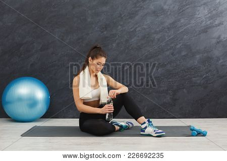 Young Sport Woman Drinking Water. Confident Fitness Girl Holding Bottle, Rest After Training, Health