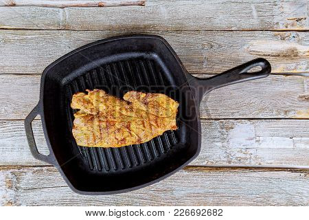 Fried Beef Steak In A Frying Pan. Roasted Pork Steak In A Frying Pan