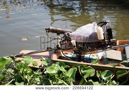 Motor Of Old Long Tail Boat Floating On River