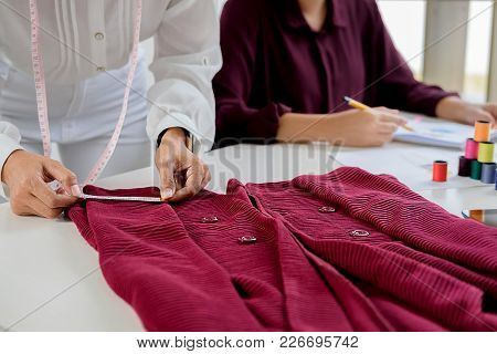 Attractive Young Woman Fashion Designer Standing And Working In Studio .