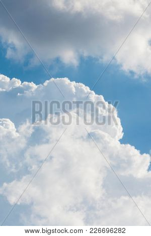 Summer sky with blue colors and very pure white clouds