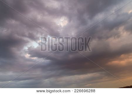Twister, Autumn sky with dark colors and very gray clouds and rain-laden