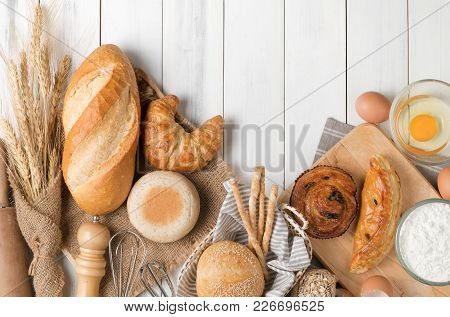 Homemade Bread Or Bakery With Fresh Egg, Flour And Bakery Equipment On White Wood Background, Breakf