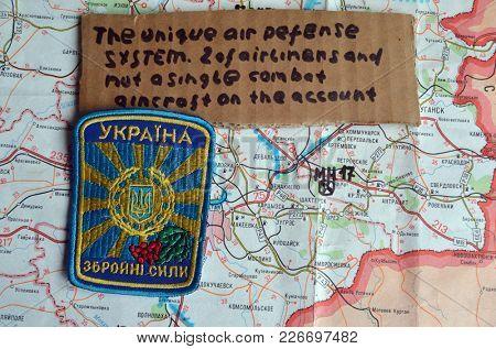 ILLUSTRATIVE EDITORIAL. Chevron of Ukrainian army. Back - Eastern Regions map.Kiev,Ukraine.February 9, 2018
