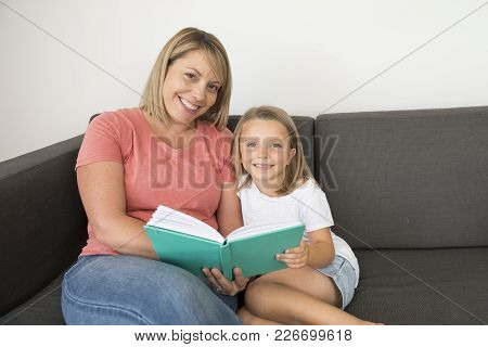 Young Beautiful And Happy Women Sitting Together With Her Adorable 7 Years Old Adorable Blond Girl R