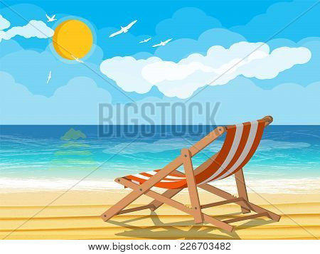 Landscape Of Wooden Chaise Lounge On Beach. Seaguls In Sky. Sun With Reflection In Water And Clouds.